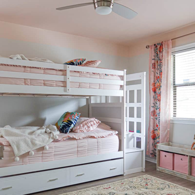 girls bedroom makeover with a pink ceiling and green accents