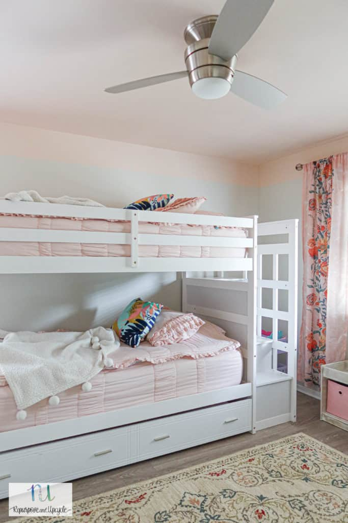 white bunk beds in girls room