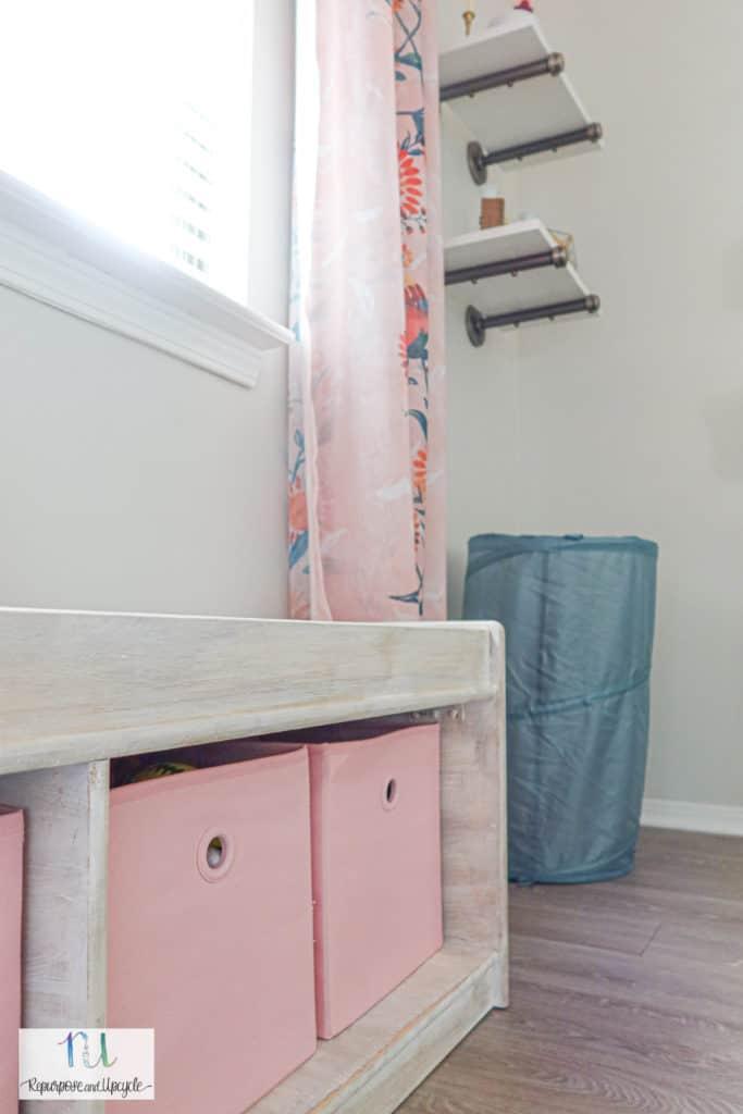 pink storage bins in storage bench