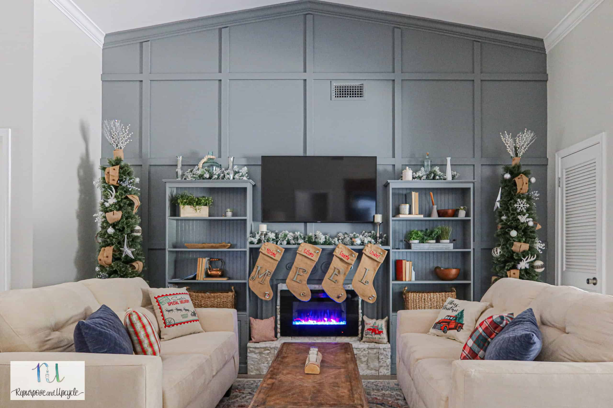 Christmas mantel with a tone on tone feature wall and electric fireplace