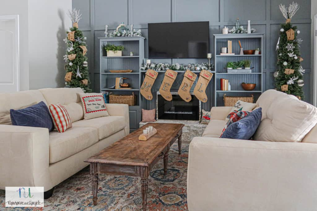 Rustic Christmas Home Tour with tone on tone blue feature wall and electric fireplace hearth