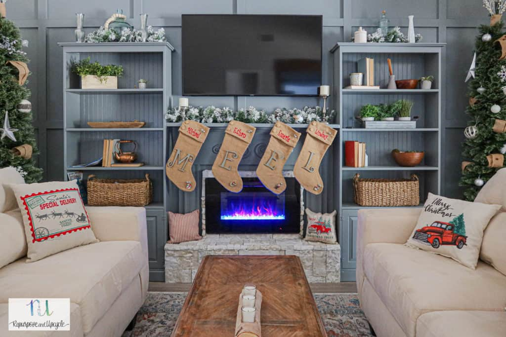 Christmas Mantel with Blue Feature Wall and Cozy Electric Fireplace