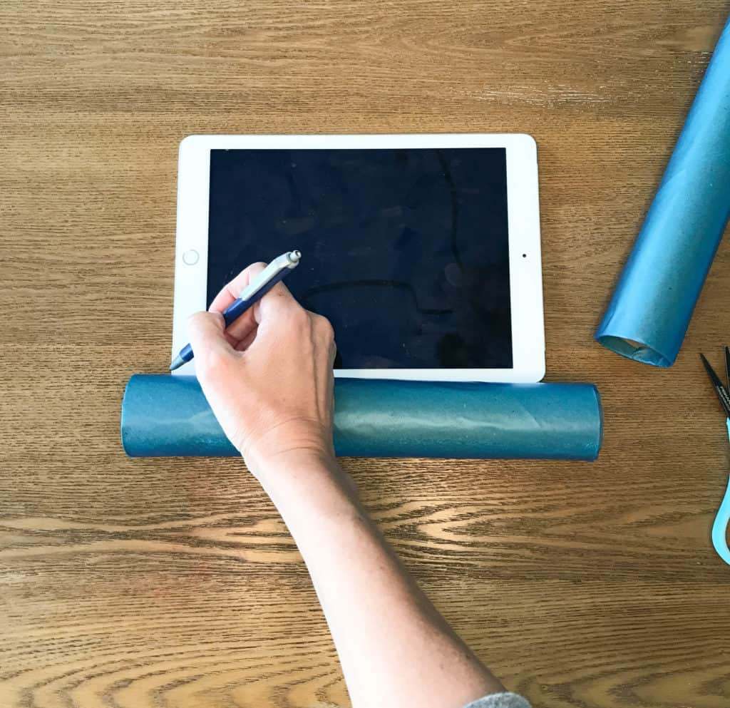 measuring the paper towel tube for the tablet holder