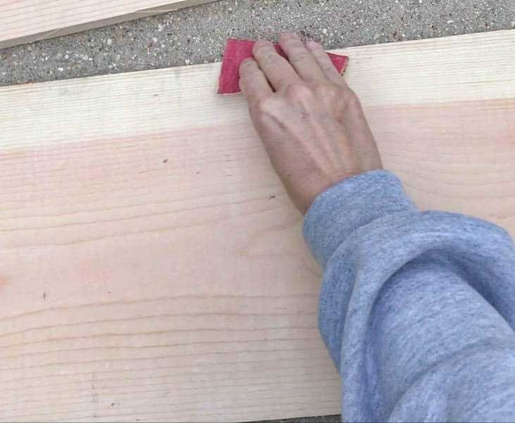 sanding the wood for the shelves