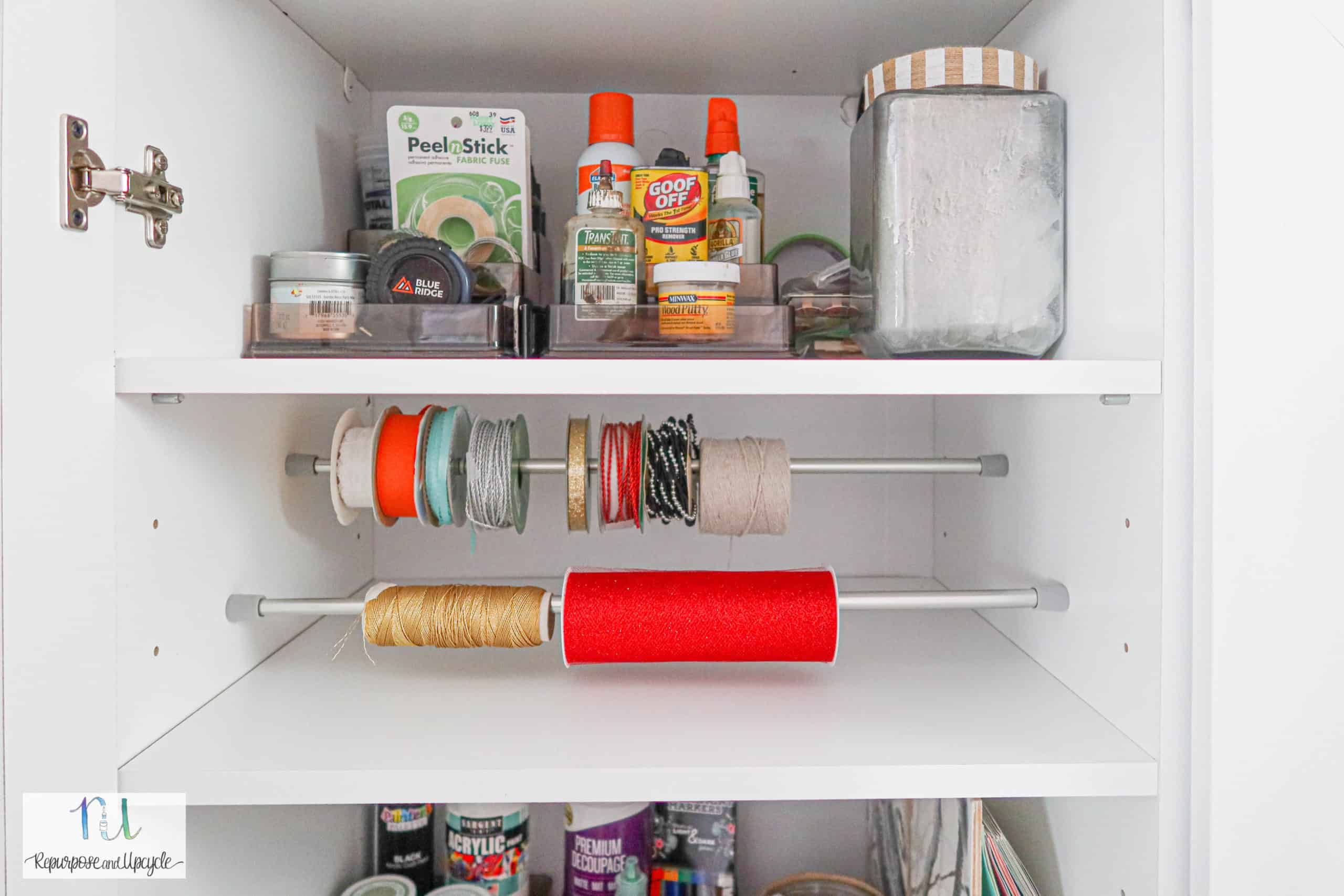 craft cabinet organization with ribbon