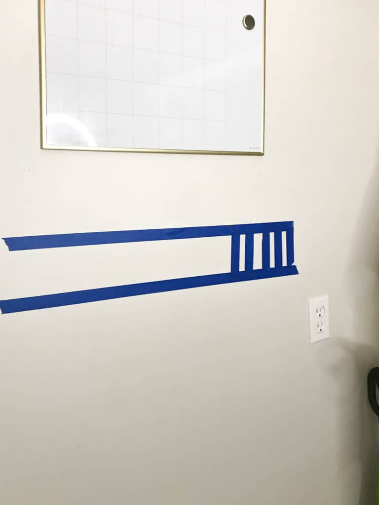 measuring the wall for boot rack
