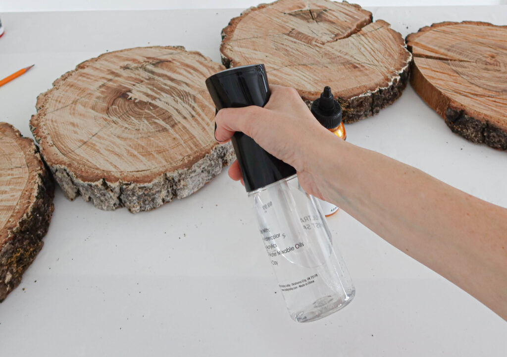 spraying water on wood slices