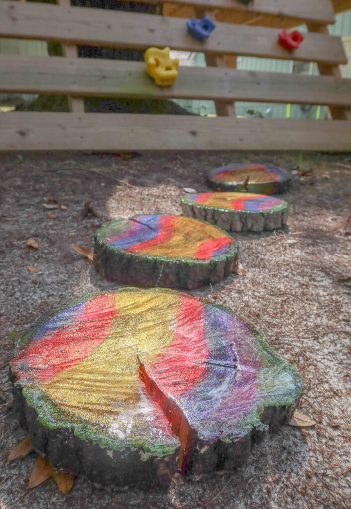 painted tree slices for stepping stones
