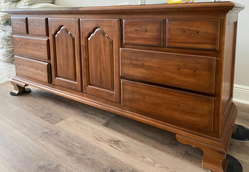 solid wood dresser with orange wood finish