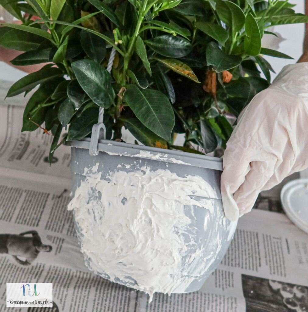 plastic pot with spackle paste