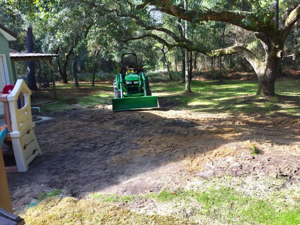 leveling the ground with a tractor