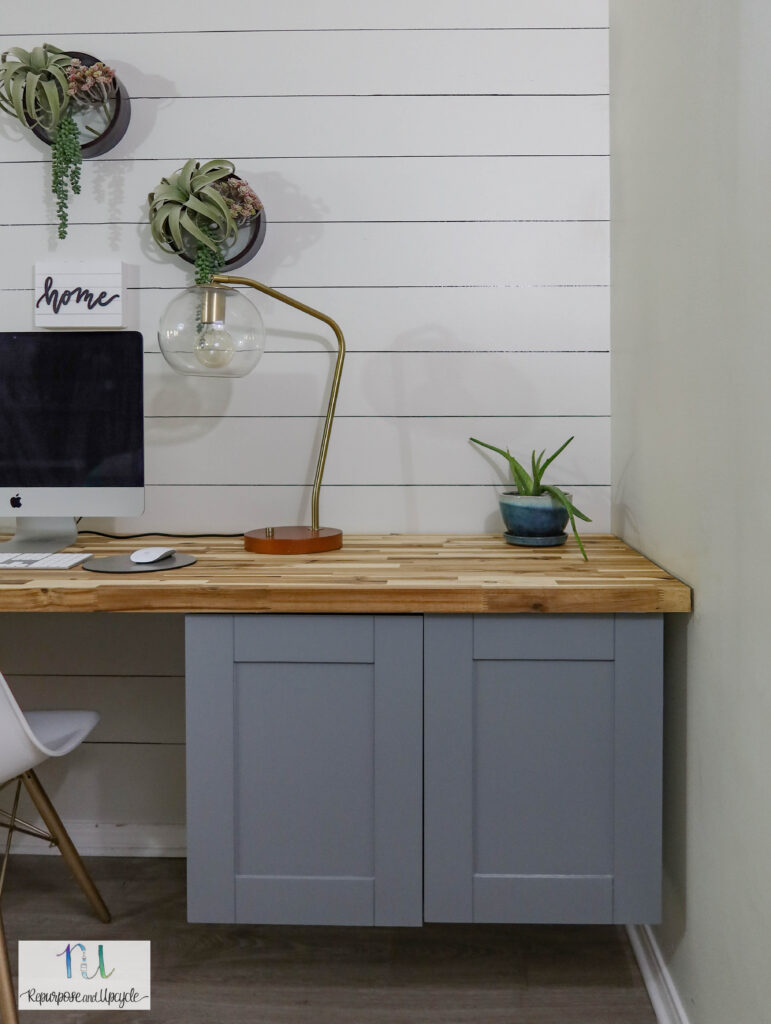 DIY floating desk from upper cabinets and butcher block