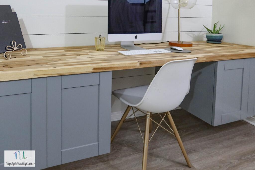 DIY modern floating desk from upper cabinets and butcher block