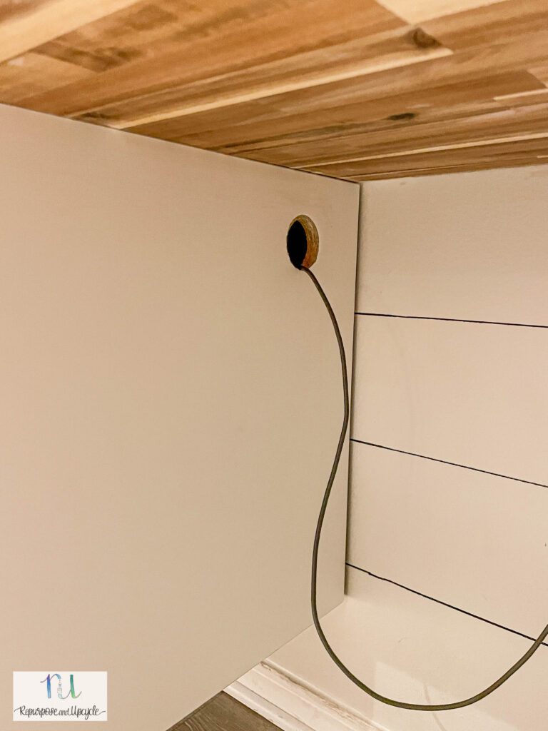 hole drilled in cabinet for cords
