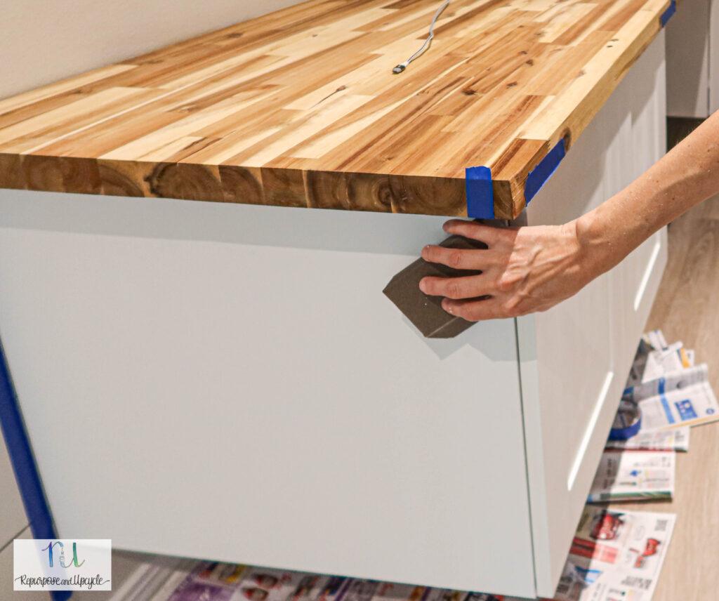 sanding primer on melamine cabinet