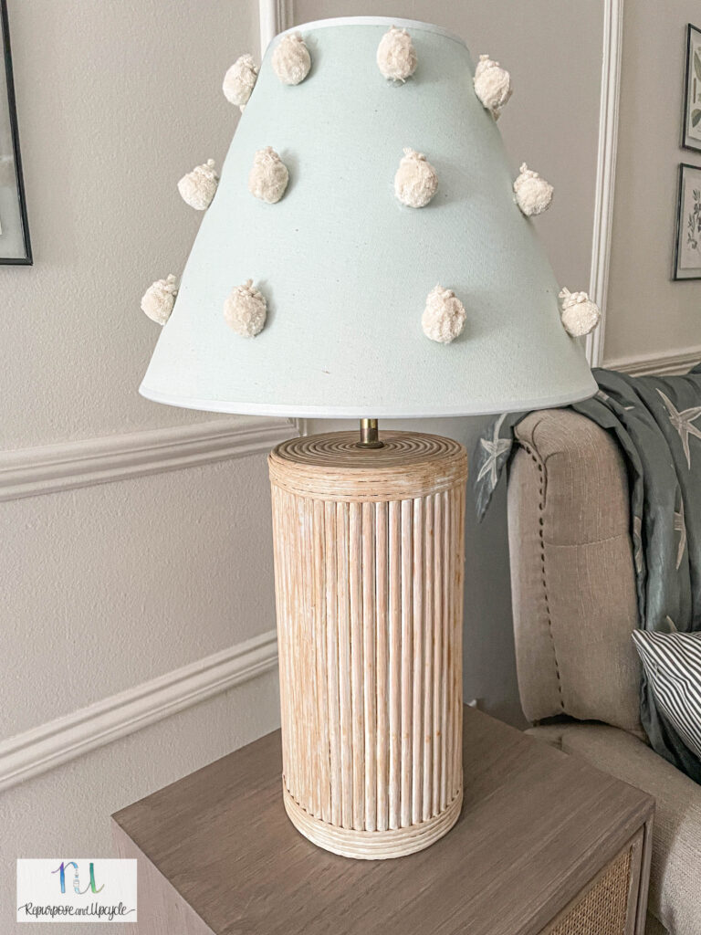 lampshade with pom pom's dyed with Rit Dye