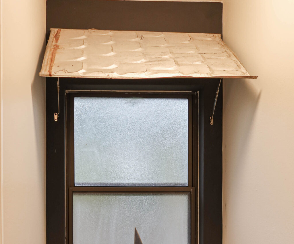 indoor awning from roofing tin over window