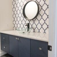 modern wallpaper accent wall in bathroom