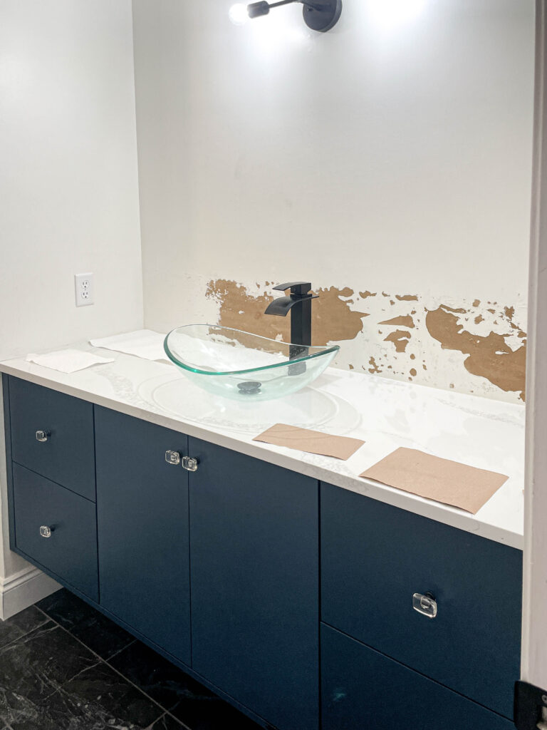 floating bathroom vanity before the wallpaper accent wall