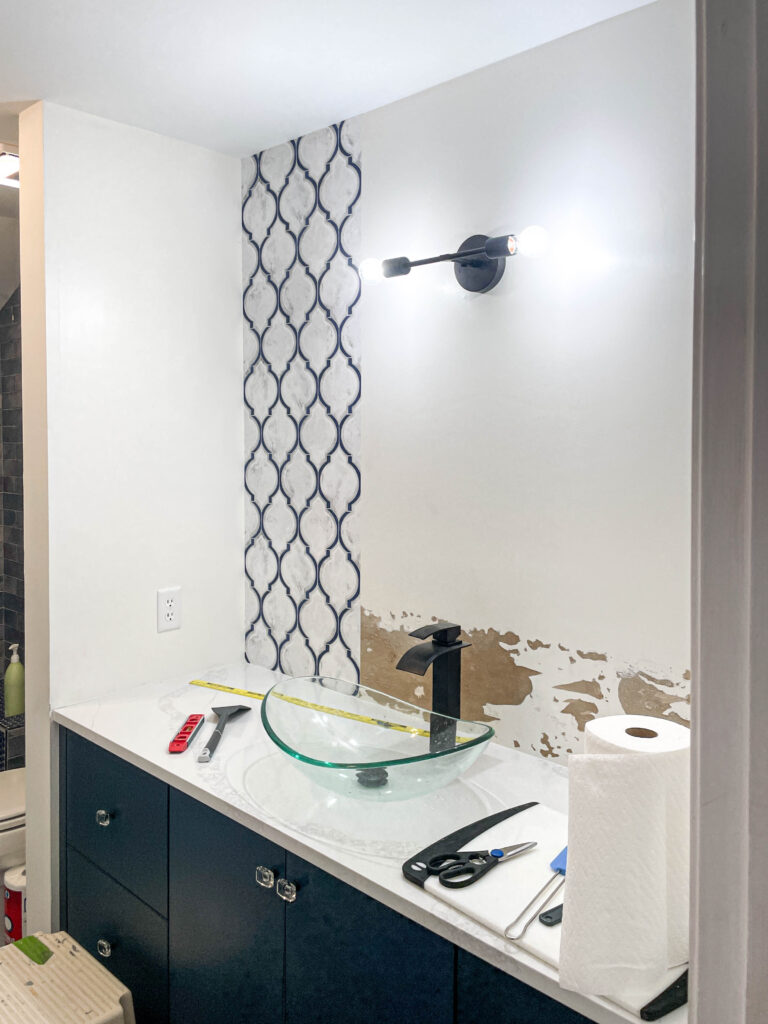 first row of wallpaper behind the vanity